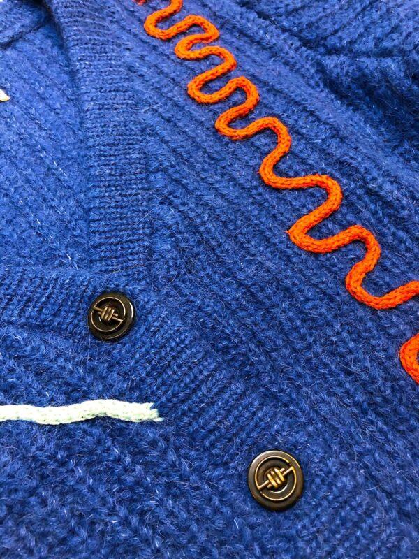 flow sweater blue details